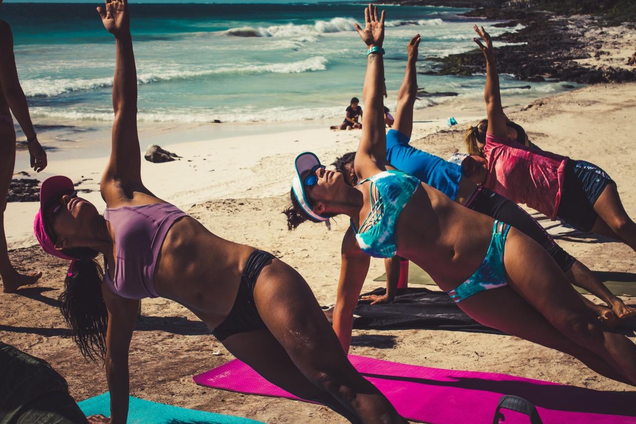 Yoga at the beach in Tulum
